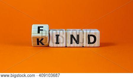 Find Your Kind Symbol. Turned Cubes With Words Find Kind. Beautiful Orange Table, Orange Background,