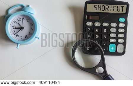 Shortcut Word Written On The Display Of A Calculator And On A White Background,