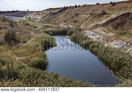 A Slope Of A Non-working Side Of A Clay Pit With Traces Of Erosion And Suffusion. Zarozhye Region, U