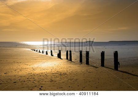 Warm Golden Sunrise Over The Beach Breakers