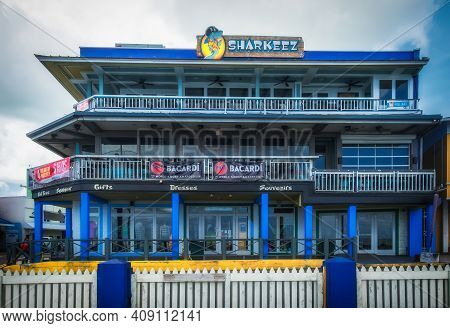Grand Cayman, Cayman Islands, July 2020, View Of The Landmark Building A Place With A Restaurant And