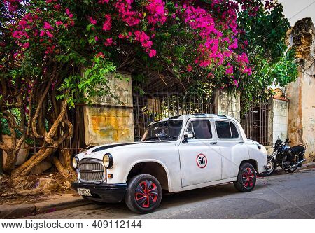 Havana, Cuba, July 2019, View Of A Retro White Car Parked In A Street In The Old Part Of The Capital