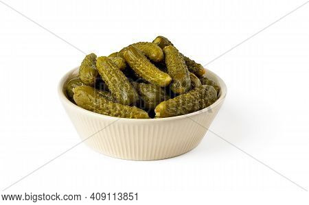 Pickled Gherkins In A Beige Ceramic Bowl Isolated On A White Background. Whole Green Cornichons Mari