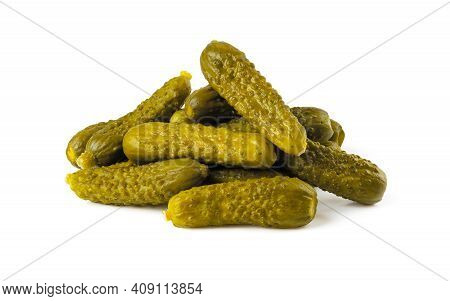 Pile Of Pickled Gherkins Isolated On A White Background. Whole Green Cornichons Marinated With Dill,