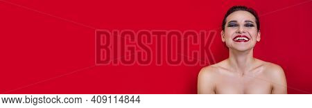 Horizontal Banner. Smiling Woman With Bright Makeup And Emotional Face Posing On Red Studio Backgrou