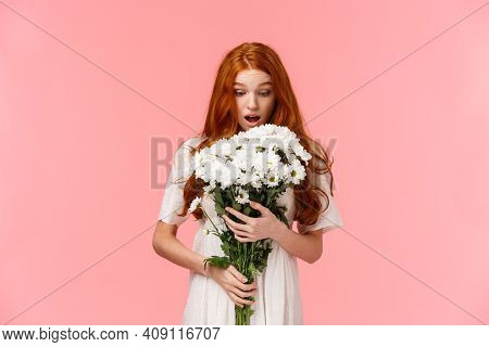 Surprised Attractive Redhead Girl Receive Romantic Valentines Day Gift, Looking At Beautiful Bouquet