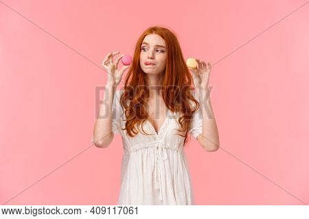 Delicious Food, Consumer And Lifestyle Concept. Attractive Picky Redhead Girl Choosing Which Dessert