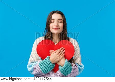 Romance, Relationship And Love Concept. Happy Dreamy Lovely Brunette Girlfriend Embracing Big Red Ca