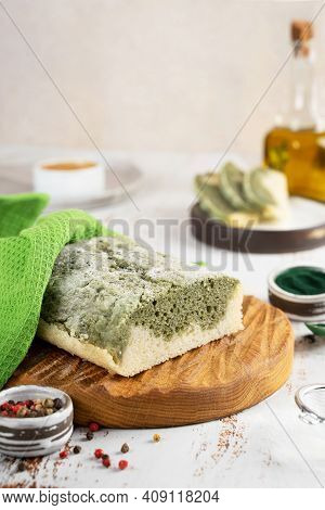 Homemade Spirulina Alternative Bread, Made From Gluten-free Rice And Flax Flour On A Wooden Oak Boar