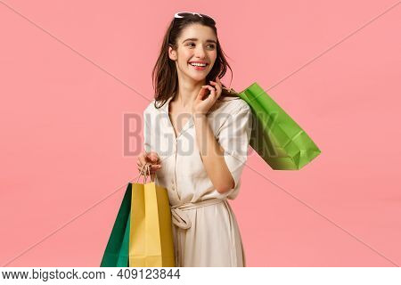 Relaxed And Carefree Glamour, Feminine Cute Girl In Dress Holding Shopping Bags And Turning Right Wi
