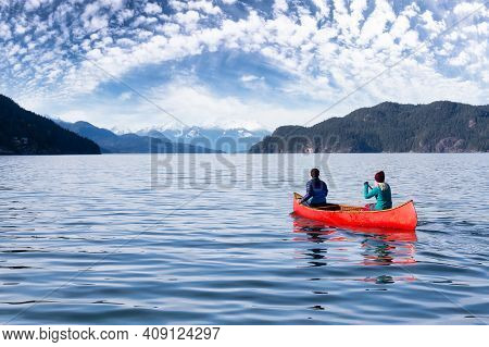 Couple Friends Canoeing On A Wooden Canoe During A Sunny Day. Colorful Sky Art Render. Taken In Harr