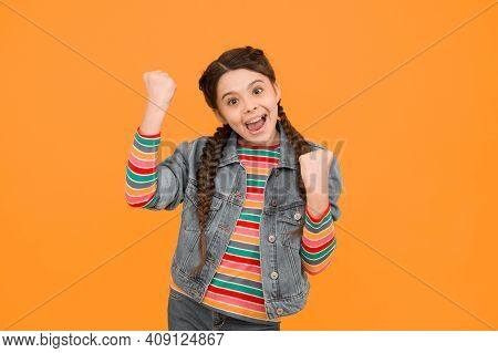 Always A Winner. Happy Little Winner Yellow Background. Small Girl Make Winner Gesture. Celebrating