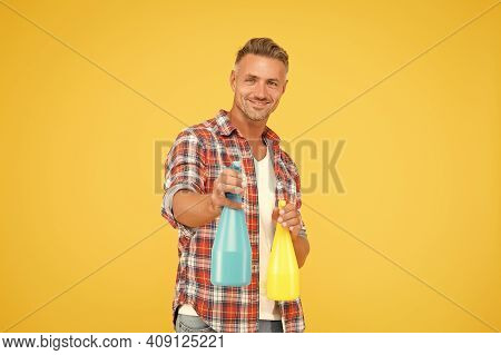 Ready To Spray. Happy Man Hold Spray Bottles Yellow Background. Spray Cleaning. Trigger Sprayer Disp
