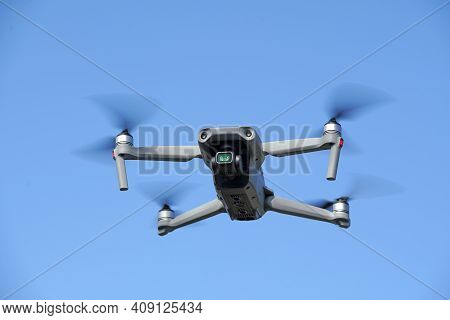 Drone Flying In Air And Clear Blue Sky Background