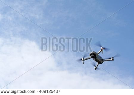 Drone Flying In Air, Blue Sky With White Clouds
