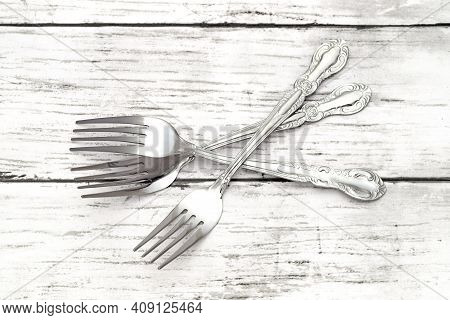 Dining Retro Silver Forks On White Grunge Wooden Table