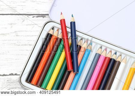 Wooden Colorful Pencils In Open Steel Box On Wooden Table