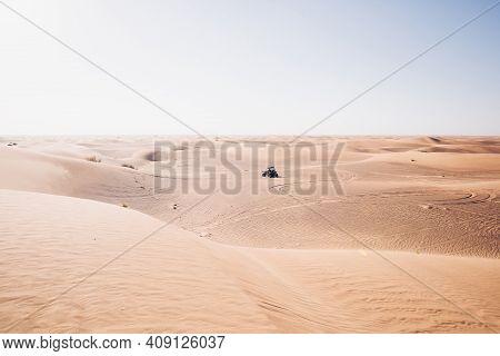 Beautiful Light Warm Silent Desert Landscape With Driving Black Buggy Quad Bike Far, Al Awir Sand Du