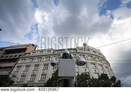 Two Dome Cctv Cameras Seen From Below In Front Of An Old Building In A European City Center Downtown
