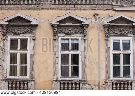 Old Windows On The Residential Building Of The Urban Area Of Belgrade Serbia, With A Damaged And Dec