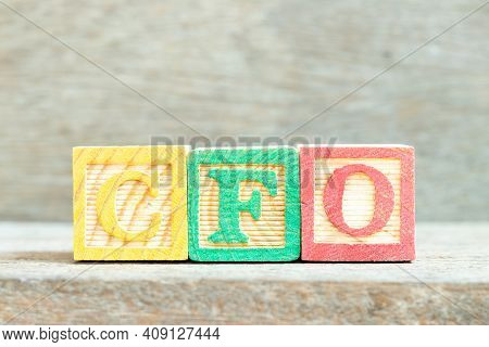 Color Alphabet Letter Block In Word Cfo (abbreviation Of Chief Financial Officer) On Wood Background
