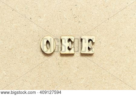 Alphabet Letter In Word Oee (abbreviation Of Overall Equipment Effectiveness) On Wood Background