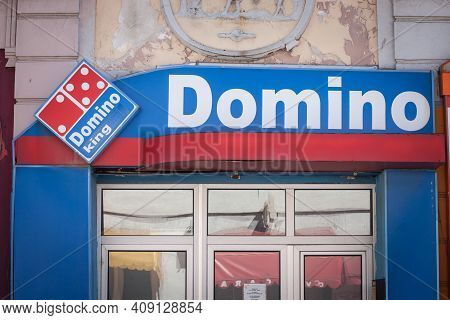 Vrsac, Serbia - August 2, 2020: Sign Of Domino King, A Fake Pizzeria Imitating Domino's Pizza, A Cha
