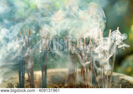 Burning Aromatic Incense Sticks. Incense For Praying Hindu And Buddha