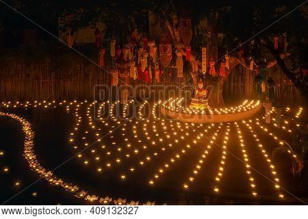 Loy Krathong Festival ,buddhist Monk Light Candles To The Buddha In Phan-tao Temple, Chiangmai, Thai