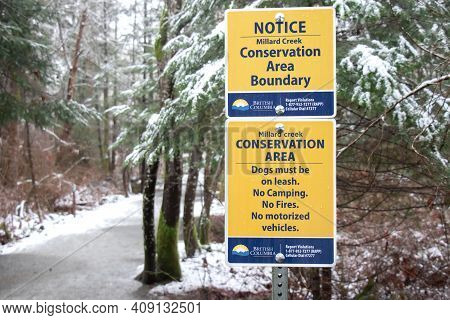 Courtenay, Canada - January 24, 2021: A View Of Sign Millard Creek Conservation Area Boundary In Cou