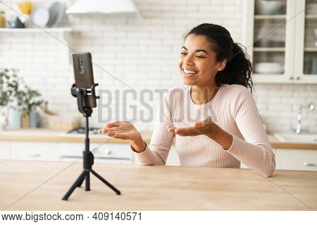 African American Woman Speaking To The Camera On The Phone On A Tripod, Gesturing, Blogging Or Speak