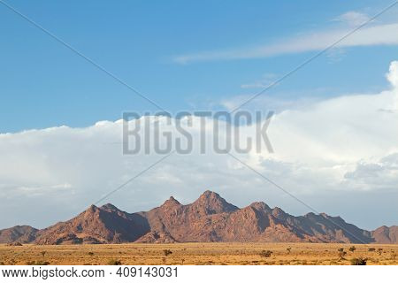 Rugged mountain landscape with cloudy sky, Namib desert, Namibia