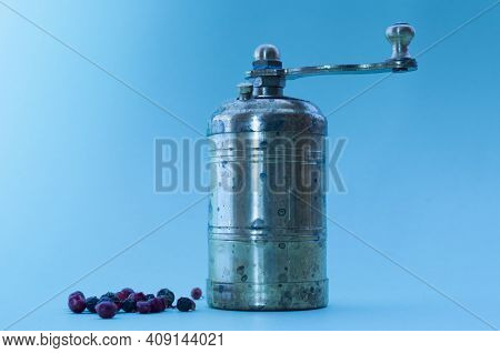Spice Mill And Pepper On A Blue Background. Background, Texture, Spices