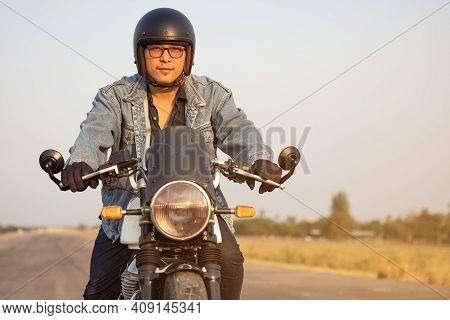 Young Man Riding Big Bike Motocycle On Asphalt High Way Against, Motorbike Man Has Freedom