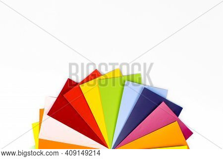 Color Palette Guide For Printing. Guide Of Paint Samples Catalog. Close-up Of Color Sample Against W