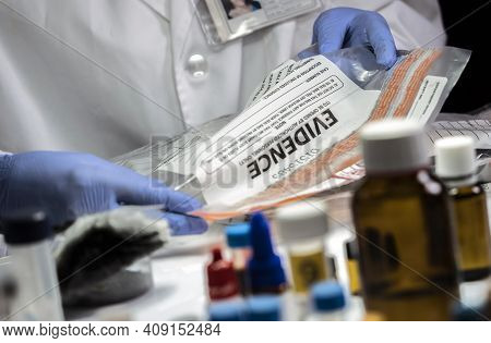 Police Specialized Taking Sample Of A Bag Of Evidence In Forensic Laboratory, Conceptual Image