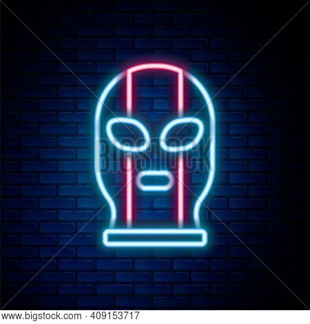 Glowing Neon Line Mexican Wrestler Icon Isolated On Brick Wall Background. Colorful Outline Concept.