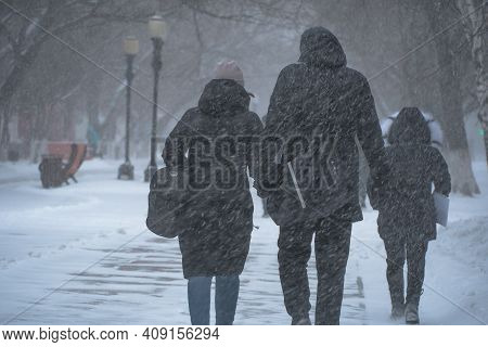 A Snow-covered Road With People In A Storm,blizzard Or Snowfall In Winter In Bad Weather In The City