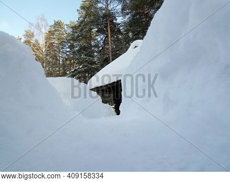 The Path To The Old Wooden House Between The Huge Snowdrifts