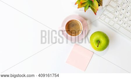 Healthy Snack And Lunch With Working In Office.  Top View Green Apple With Back Coffee Pink Cup For