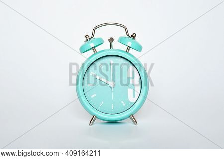 Selective Focus Green Mint Vintage Clock Show 10 O'clock On White Gray Background. Time's Concept.
