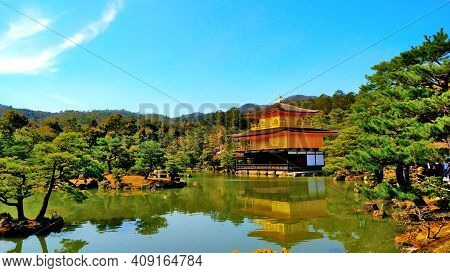 Golden Pavilion In The Japanese City Of Kyoto. The Beautiful Park Around Belongs To The Complex. It'