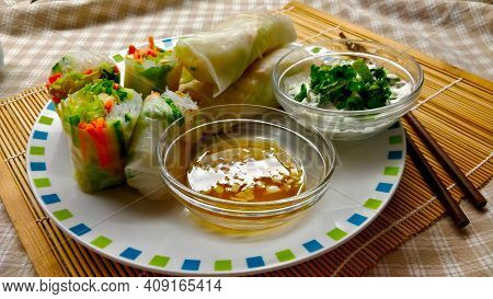 Delicious Vietnamese Spring Rolls Full Of Fresh Vegetable And Glass Noodles With Typical Vinegar Sau