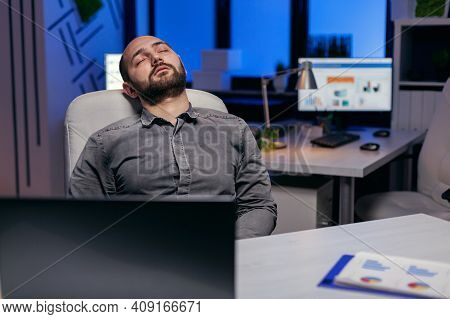 Exhausted Hardworking Businessman Sleeping On Chair. Workaholic Employee Falling Asleep Because Of W