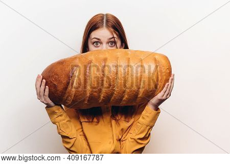 Happy Woman With A Loaf Of Bread In Hand A Loaf In A Horizontal Position On A Light Background