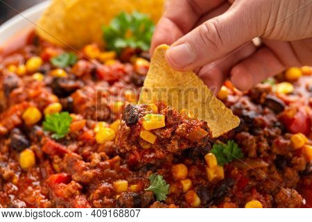 Chilli Con Carne With Tortilla Chips And Cheese In White Bowl. Mexican Food.