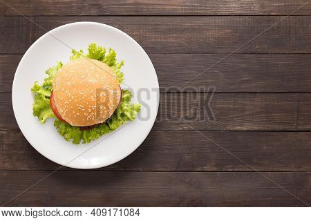Delicious Burger With Sauce. Hamburger. Delicious Grilled Angus Burger With Cheese, Salad And Tomato