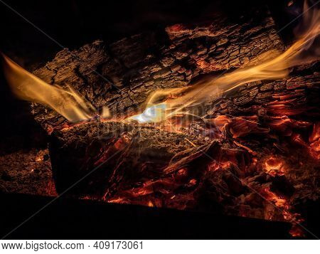 Burning Billets In Fireplace As Abstract Background