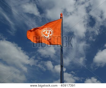 Flag with a sign Om or Aum --is a sacred mystical syllable in the Dharma or Indian religions i.e. Hinduism Jainism and Buddhism poster