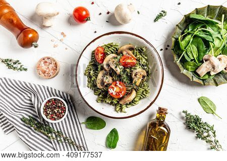 Vegetable Green Pasta Spinach Leaves And Cherry Tomatoes. Green Vegan Pasta With Spinach Leaves. Hea